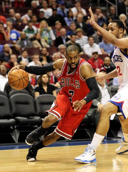 Chicago Bulls point guard C.J. Watson drives on Philadelphia 76ers shooting guard Evan Turner (12) in the first half of game 6 of the first round of NBA playoffs at Wells Fargo Center in Philadelphia.