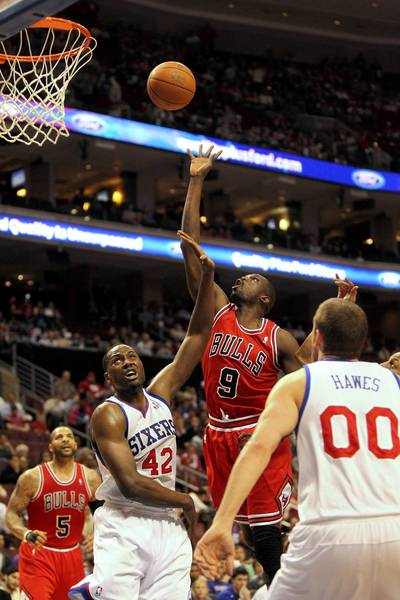 Chicago Bulls small forward Luol Deng puts up a shot over Philadelphia 76ers power forward Elton Brand in the first half of game 6 of the first round of NBA playoffs at Wells Fargo Center in Philadelphia.