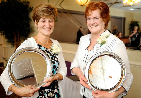 Paula Lampton, left, and Judy Lyons Wolf were honored with Life of Leadership awards Thursday during the 12th annual Life of Leadership Dinner and Celebration sponsored by Women at the Table.