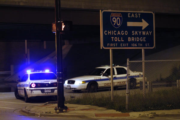 Chicago police block the ramp to the Chicago Skyway at 66th and State Streets as police search for possible sniper who may have struck seven vehicles, in Chicago, Wednesday, May 9, 2012.
