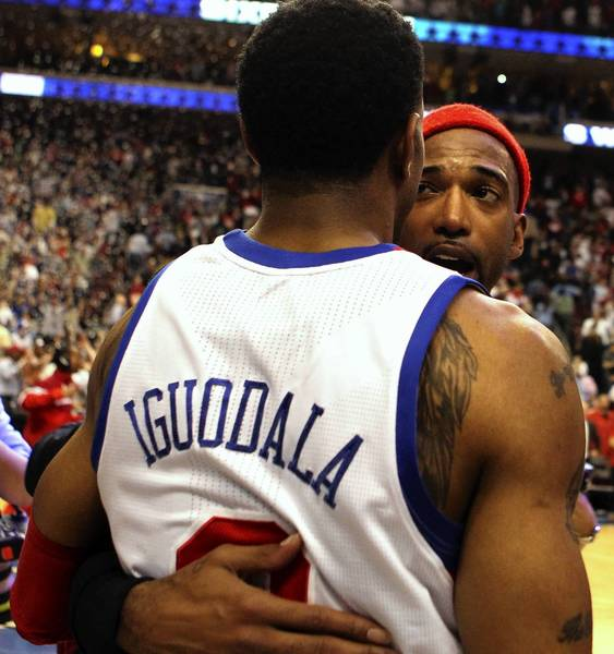 Philadelphia 76ers small forward Andre Iguodala is congratulated by Chicago Bulls shooting guard Richard Hamilton after game 6 of the first round of NBA playoffs at Wells Fargo Center in Philadelphia.