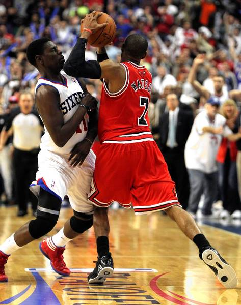 Philadelphia 76ers point guard Jrue Holiday applies pressure to Chicago Bulls point guard C.J. Watson before Watson took a last second shot that missed in game 6 of the first round of NBA playoffs at Wells Fargo Center in Philadelphia.