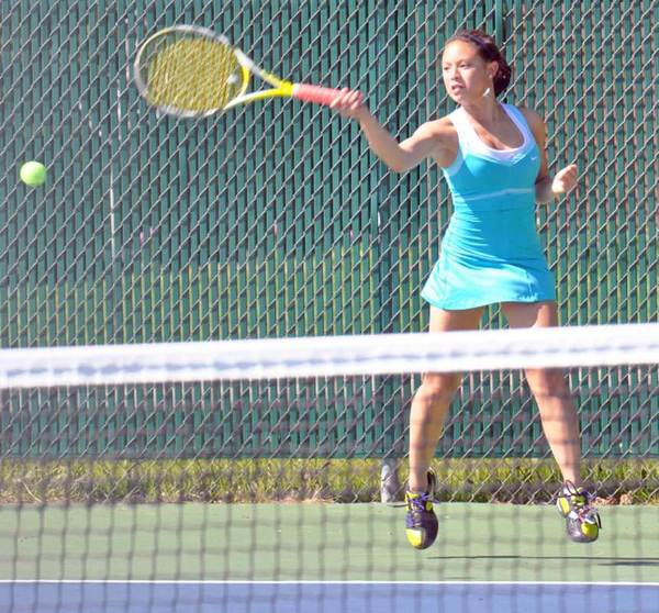 Isabel Cenzina of Petoskey returns during her match at No. 1 singles Thursday against Traverse City Central.