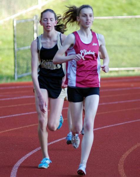Charlevoix junior Olivia Certa (right) leads St. Ignace's Sarah Cullip during the 3200-meter run at Thursday's East Jordan Invitational at Boswell Stadium. Certa won the race in 11 minutes, 53.66 seconds.