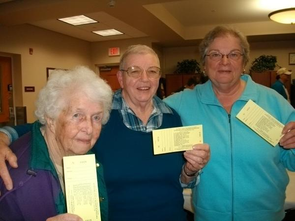 Holding raffle tickets for the annual Bay Bluffs Emmet County Medical Care Facility Auxiliary raffle fundraiser are (from left) auxiliary members Marcella Fisher, Clara Corey and president Marge Ward.