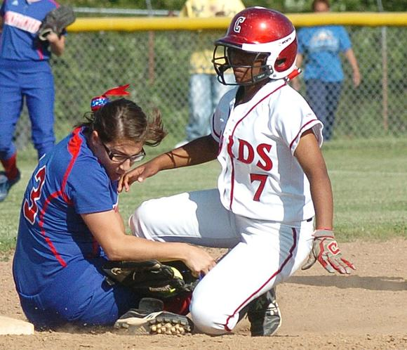 Clark base runner Skye Skinner slides into second base as Montgomery County¿s Lilly Setters applies the tag in the second inning of the Lady Cardinals¿ 7-5 loss to the Lady Indians Wednesday night at Cardinal Heights.