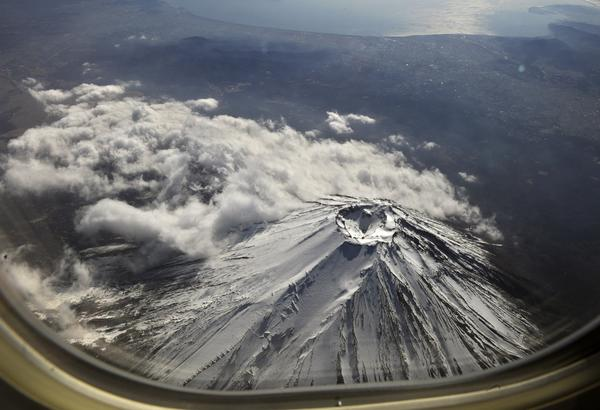 This aerial picture shows the top of Japan's Mount Fuji, a national symbol and key tourist attraction, taken from a commercial jet plane flying over Yamanashi prefecture on February 3, 2011. Mount Fuji could collapse if a newly-discovered faultline under the mountain shifts, a government-commissioned report has warned.