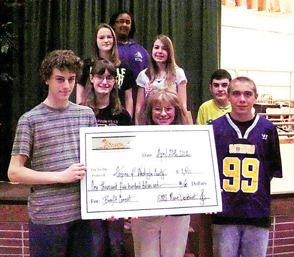 Smithsburg Middle School students presented Hospice of Washington County Development Director Cheryl Brown, front row second from left, with a check for $1,500.