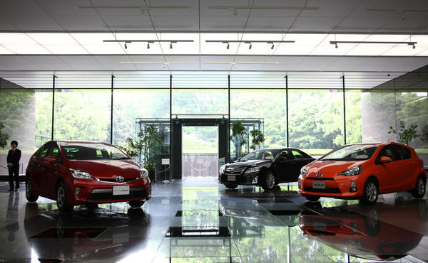 Toyota Motor Corp. Prius plug-in, from left, Camry, and Aqua hybrid vehicles are displayed at the company's Tokyo head offices in Tokyo, Japan