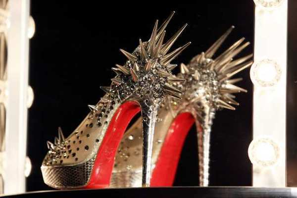 A shoe at a preview of an exhibition by French shoe designer Christian Louboutin at the Design Museum in London. Louboutin is now venturing into the beauty industry.