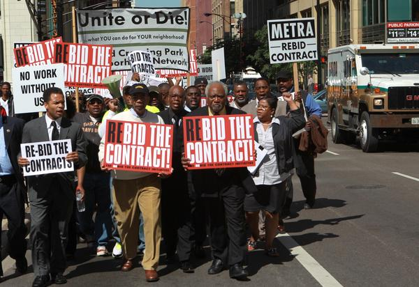 U.S. Reps. Jesse Jackson Jr., Bobby Rush and Danny Davis, lead protesters in a march on Jackson Boulevard against the Metra contract bidding process that they feel unfairly excludes African-Americans.