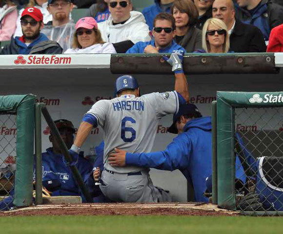 Jerry Hairston is helped down the steps of the dugout after injuring his leg against the Chicago Cubs at Wrigley Field.