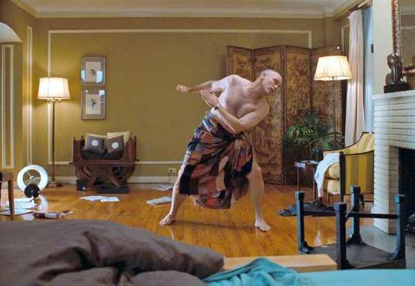 "John Malkovich as John Horatio Malkovich, dancing like a marionette in Spike Jonze's surreal and hilarious ""Being John Malkovich."""
