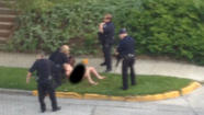 A naked suspect, whom Bloomington Police shot, continued to recover at IU Health Bloomington Hospital Friday evening.