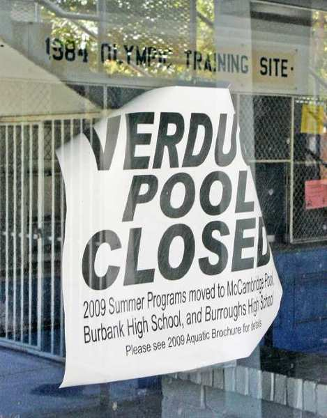 A sign, that seems to have been on the door since 2009, with the 1984 Olympic Training Site sign inside. The pool has been closed since 2008.