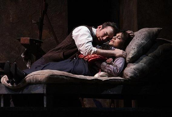 "Stephen Costello (Rodolfo) and Ailyn Pérez (Mimi) in the death scene of LA Opera's Herbert Ross production of ""La Boheme"" at the Dorothy Chandler Pavilion. Conductor Patrick Summers, of Houston Grand Opera, makes his company debut."