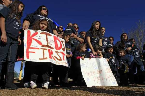 Parents of the Desert Trails Parent Union rally at Mgrdichian Park in Adelanto. Desert Trails is, by any measure, a failing school, and has been for six years in a row.