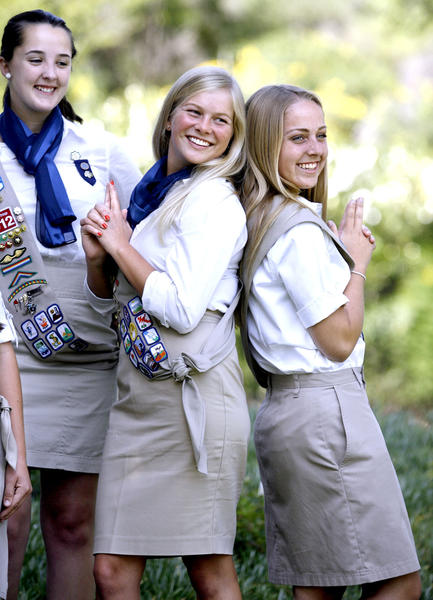 Girl Scouts Gold Award candidate Erin McCoy, left, looks over at Olivia Hudnut, center, and Maren (cq) Owen, right, as they strike a playful pose during photo session at rehearsal for the upcoming La Canada Girl Scout Service Unit Gold, Silver & Bronze Award Ceremony.