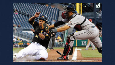 Pittsburgh Pirates' Jose Tabata, left, is tagged out by Houston Astros catcher Jason Castro during the fourth inning of a baseball game in Pittsburgh on Friday.