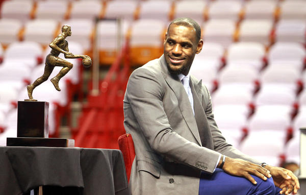 Lebron James looks at his trophy after he was named the NBA's most valuable player for the third time in the last four years.