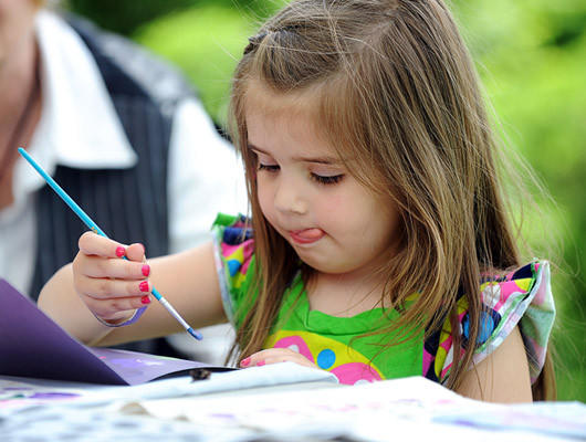 Amelia Ristila 4, of Tamaqua concentrates on painting a mothers day card at Stonehedge Gardens during the Mother Earth Festival in Tamaqua Saturday afternoon. The festival celebrated a day of art, music, workshops, crafters and food to benefit Stonehedge Gardens.