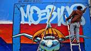 In San Francisco's Mission District, touring Clarion Alley murals