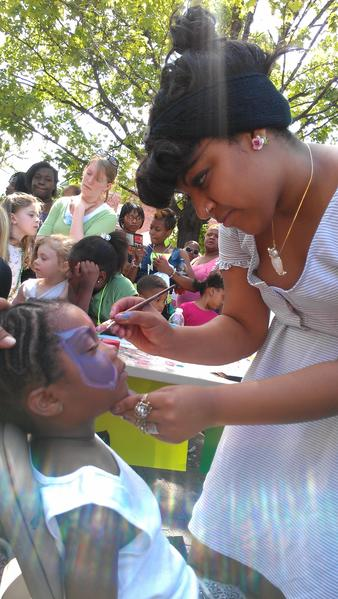 Marissa Cartagena, a 19-year-old Maryland Institute College of Art student, carefully painted a butterfly on two-year-old Kendall Jones' face during the Boundary Block Party in Upton on Saturday, an event started five years ago to bridge the gap between racially divided neighborhoods in West Baltimore.