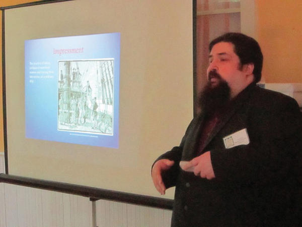 Chris Cox, a historian with the Berkeley County Historical Society, lectures Saturday on Berkeley County's role in the War of 1812 at the 200th anniversary celebration of the building of the Boydville mansion in Martinsburg, W.Va.