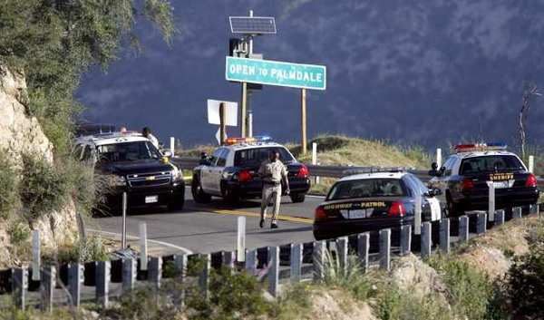 California Highway Patrol and L.A. County Sheriff personnel investigate a reported body on the roadway on Angeles Crest Highway above La Canada Flintridge around mile marker 27.