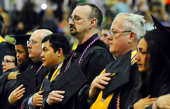 Roger Grimm, center, was one of several students whose story was highlighted Saturday during Hagerstown Community College commencement.