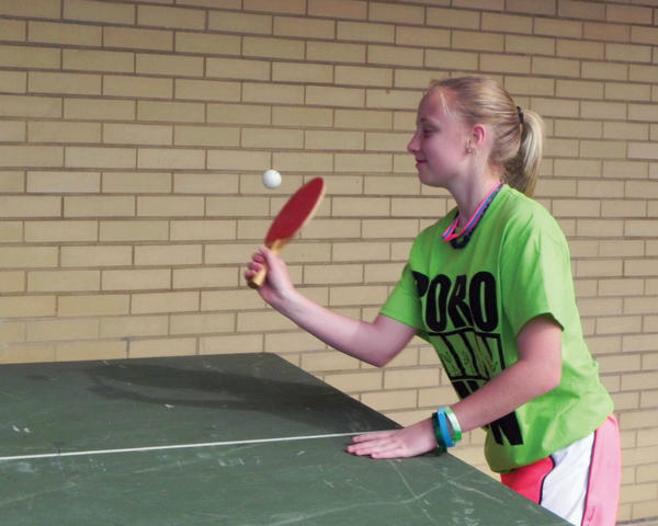 Erika Cauffman, 14, plays pingpong on Saturday at the Waynesboro Mini-THON at Waynesboro (Pa.) Area Senior High School.