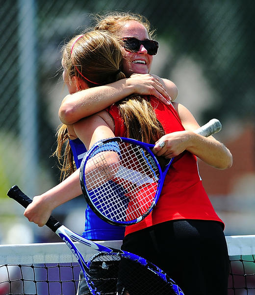 Boonsboro's Ashlyn Hawbaker, back, hugs North Hagerstown's Kelli Wright following the girls doubles final at the Washington County Championships on Saturday. Hawbaker and Sarah Colgan defeated Wright and Sam Roberts for the title.