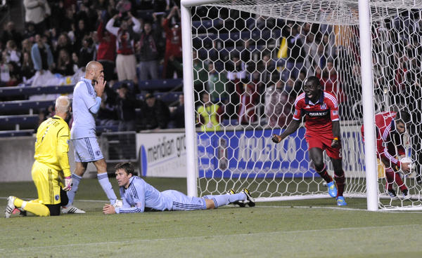 Dominic Oduro celebrates his goal as (L-R) Jimmy Nielsen, Aurelien Collin and Matt Besler of Sporting Kansas City look on.