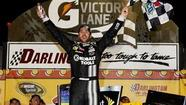 Jimmie Johnson  broke free on a restart three laps from the end in the Southern 500 and held on Saturday night to give Hendrick Motorsports its 200th Sprint Cup victory.