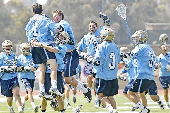 The Corona del Mar High boys' lacrosse team celebrates after defeating Palos Verdes, 7-6, in the U.S. Lacrosse Southern Section title game, held at Mission Viejo High Saturday.