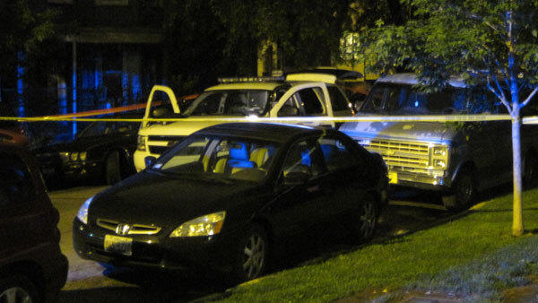A Chicago police SUV guards the scene of a homicide in Logan Square on May 13, 2012.