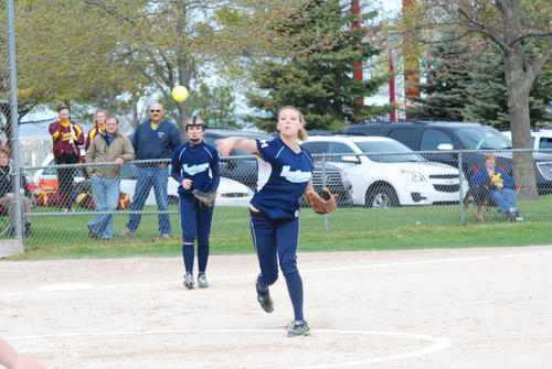Annie Hansen (right) throws to first base as Emily Kent looks on Saturday at Bayfront Park's Ed White Field.