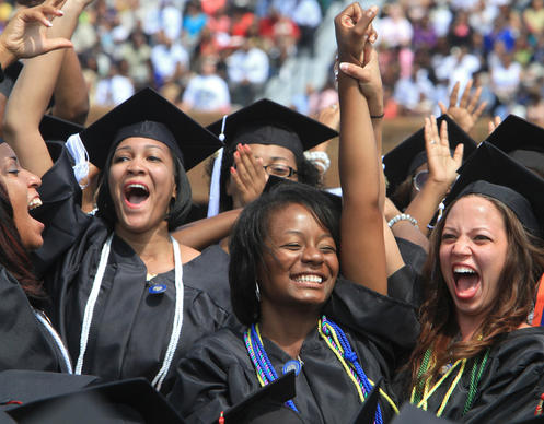Graduates of the Department of Education celebrate during Hampton University's graduation ceremony at Armstrong Stadium on Sunday.