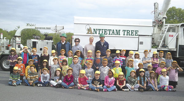 Potomac Heights Elementary School kindergarten students planted a dogwood tree in front of the school in honor of Arbor Day on April 26. The tree was donated by the owners of Antietam Tree & Turf, Roger, Edith, Randy and Anita Finn.