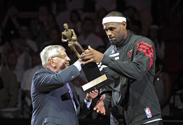 Miami Heat forward LeBron James receives the MVP trophy from NBA Commissioner David Stern before the start of the Heat's game against the Indiana Pacers.