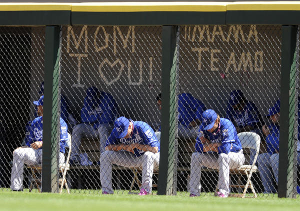 Royals pitchers sitting in the bullpen leave a Mother's Day message.