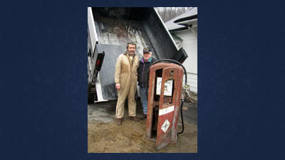 Dave Stubbs, left, and Gordon Zeak with a 60-year-old Bennett gas pump prior to its restoration. The refurbished pump can be viewed today at the Lincoln Highway Experience museum.