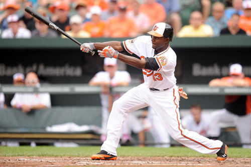 Xavier Avery takes a swing during his first major league game.
