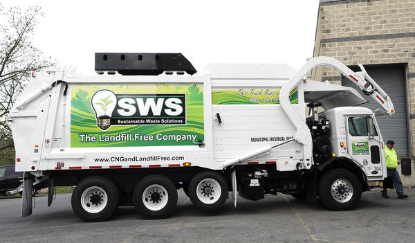 Nick DiCiacco of Perkiomenville, a front-load driver for SWS, collects refuse with his company's compressed natural gas garbage truck on the campus of Muhlenberg College Wednesday. As far as he knows it is the only one of its kind in Pennsylvania.