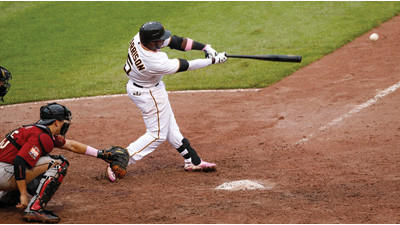 Pittsburgh Pirates' Josh Harrison drives in the winning run in the 12th inning against the Houston Astros on Sunday.