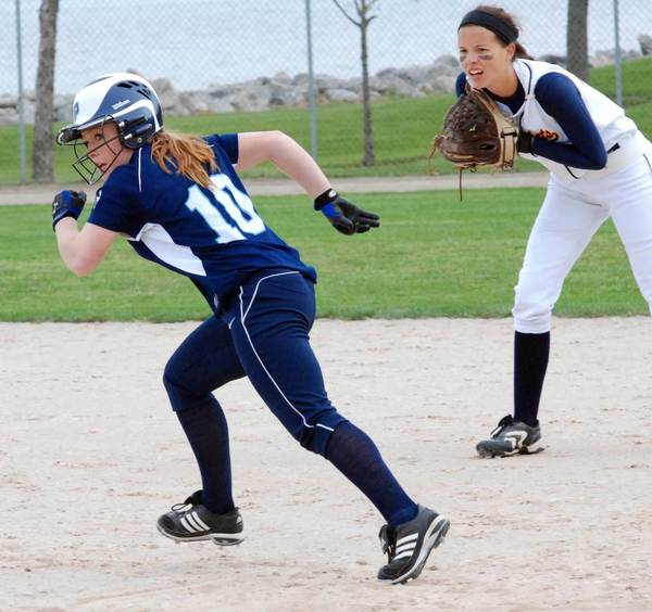 Jenna Proctor of Petoskey (10) takes off for second base Saturday during the annual Jennifer Kullik Invitational at Ed White Field.