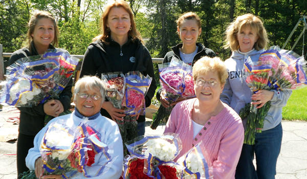 "Birthright Volunteers ""Satch"" Booth-Rosage, Bonnie Johnson, Leah Young, Terri McConnell, Rosie Clark and Maureen Clark prepare carnations for Birthright's Mother's Day Celebration."