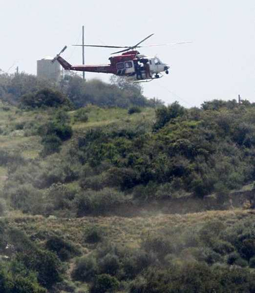 Air crews search over the Verdugo Mountains in Glendale on Monday, May 14, for Stephen Ivens, 35, a Los Angeles-based FBI agent who was last seen at his Burbank home Thursday night.