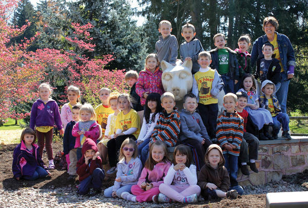 Children from the Waynesboro (Pa.) Area YMCA's Ys Nest preschool program for 4- and 5-year-olds gather for a photo with teacher Melody Gober, top right, in front of the Nittany Lion statue at Penn State Mont Alto.