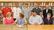 George¿Rogers Clark senior Adam Fatkin signs a national letter-of-intent with Rockhurst University (Kansas City, Mo.) Monday at the school. Joining Fatkin on the front row from left are: Mother Debbie Fatkin, father Mark Fatkin and grandmother Gail Cox. Back row from left: Clark coach Scott Humphrey, friend Charlie Rogers, brother Eric Fatkin, brother Austin Fatkin and grandfather Stewart Cox.